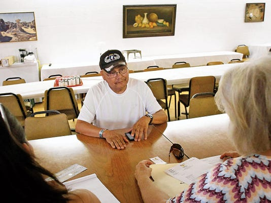 Mike Bekis of Upper Fruitland speaks with San Juan County Commissioner Margaret McDaniel Thursday during a meeting for the 'Honoring Our Women Veterans' walk at Chef Bernie's in Farmington.