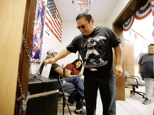 Philo Pinto casts his ballot in the Navajo Nation referendum election during early voting at the Navajo Election Administration's Northern Agency Office in Shiprock. Voters will head to the polls to Tuesday to decide the election.