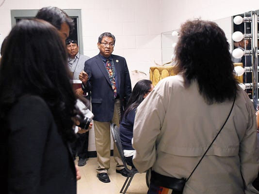 Navajo Nation President Russell Begaye talks with his staff Thursday before a public meeting at the Phil Thomas Performing Arts Center in Shiprock.