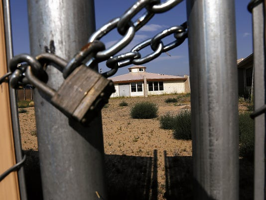 A locked gate encircles the Shiprock Home for Women and Children on July 20 in Shiprock.