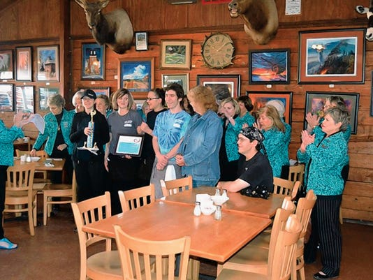 Ruidoso Valley Chamber of Commerce Greeters recognize the entire Sunday morning staff at the Log Cabin Restaurant as champions of service this week.