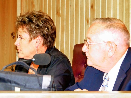Village Manager Debi Lee listens to councilors with Dan Bryant, former village attorney and now a district court judge.