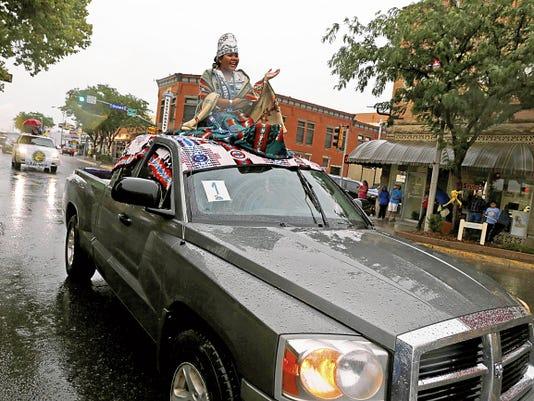 Olivia Davis, Miss Farmington High School, waves Friday during the San Juan County Fair parade in downtown Farmington.