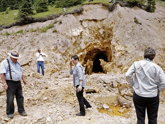 Ernest Kuhlman, left, chairman of the San Juan County (Colo.) Commission and Gwen Lachelt, second from right, a La Plata County (Colo.) Commissioner, on Aug. 10 inspect the site where the Gold King Mine breached north of Silverton, Colo.