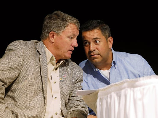 San Juan County Executive Office Kim Carpenter speaks with Rep. Ben Ray Luján, D-N.M., during a town hall meeting Aug. 8 at the Farmington Civic Center about the Gold King Mine spill.