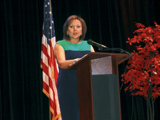 New Mexico Gov. Susana Martinez announces a new energy plan on Monday at the Southeast New Mexico Oil and Gas Summit in Carlsbad.