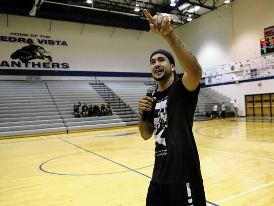 Kenny Dobbs talks Thursday during a community event at the Jerry A. Conner Fieldhouse in Farmington.