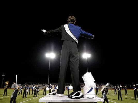 Members of the Piedra Vista High School marching band perform Friday during the Piedra Vista High School homecoming ceremony at Hutchison Stadium in Farmington.