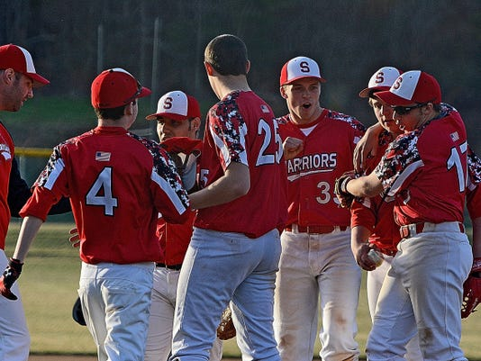 The Susquehannock players celebrate their 9-7 home victory over Eastern York on Monday.