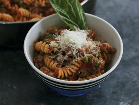 Fusilli with Italian sausage, peas and creamy tomato sauce. (AP Photo/Matthew Mead)