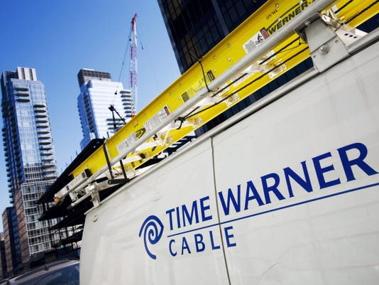 FILE - This Feb. 2, 2009 file photo shows a Time Warner Cable truck in New York .Charter Communications is close to buying Time Warner Cable for about 55 billion, two people familiar with the negotiations said Monday, May 25, 2015. (AP Photo/Mark Lennihan, File)