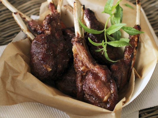Sweet and Spicy Grilled Lamb Chops. (AP Photo/Matthew Mead)