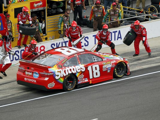 Sprint Cup Series driver Kyle Busch (18) pits during the NASCAR Brickyard 400 auto race at Indianapolis Motor Speedway on Sunday. Busch won the race. (AP Photo/AJ Mast)