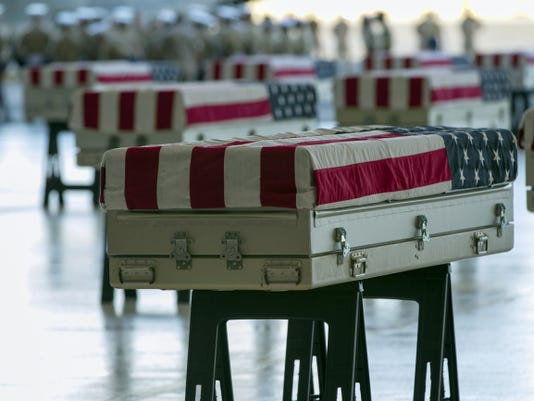 The remains of 36 unidentified U.S. Marines found at a World War II battlefield are displayed during a ceremony at Joint Base Pearl Harbor-Hickam, Sunday, July 26, 2015, in Honolulu. A Florida-based private organization called History Flight recovered the remains from the remote Pacific atoll of Tarawa. (AP Photo/Marco Garcia)