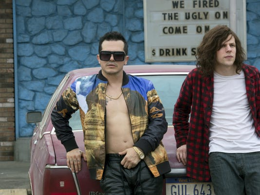 "John Leguizamo, left, and Jesse Eisenberg appear in ""American Ultra."""