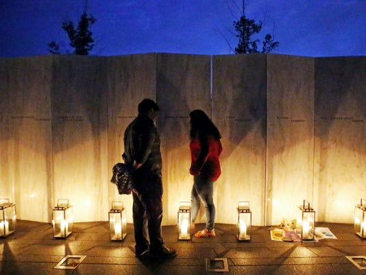 Jody Greene, right, whose father Donald Greene, was on United Flight 93, visits his name on the Wall of Names at the Flight 93 National Memorial in Shanksville, Pa, Thursday, Sept. 10, 2015. The new 26 million visitors' complex is expected to draw a larger crowd than normal for the 14th anniversary observance at the Flight 93 National Memorial. (AP Photo/Gene J. Puskar)