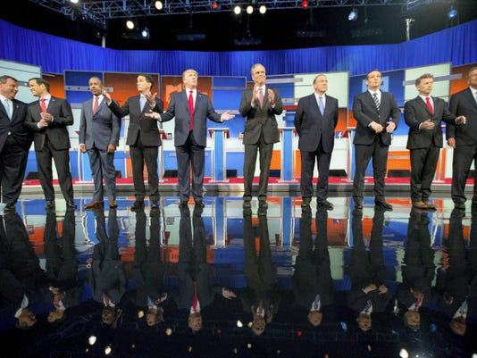 FILE - In this Aug. 6, 2015, file photo, Republican presidential candidates from left, Chris Christie, Marco Rubio, Ben Carson, Scott Walker, Donald Trump, Jeb Bush, Mike Huckabee, Ted Cruz, Rand Paul, and John Kasich take the stage for the first Republican presidential debate in Cleveland.  Eleven top-tier Republican presidential hopefuls face off in their second prime-time debate of the 2016 campaign Sept. 16, in a clash between outsiders and establishment candidates under a cathedral of political conservatism. (AP Photo/Andrew Harnik, File)