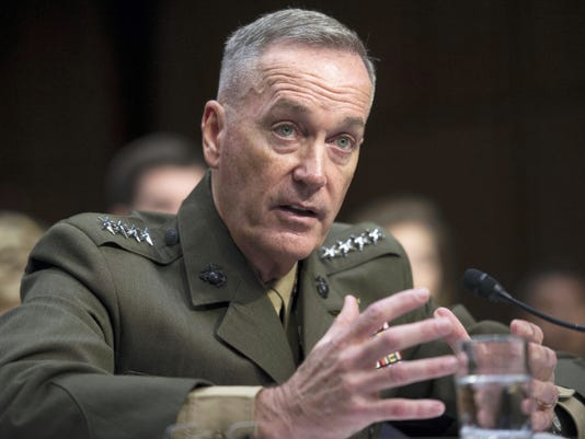 FILE - In this July 9, 2015, file photo, then-Marine Corps Commandant Gen. Joseph Dunford, Jr., testifies during his Senate Armed Services Committee confirmation hearing to become the Chairman of the Joint Chiefs of Staff, on Capitol Hill in Washington. The Marine Corps is expected to ask that women not be allowed to compete for several front-line combat jobs, inflaming tensions between Navy and Marine leaders, U.S. officials say. The tentative decision has ignited a debate over whether Navy Secretary Ray Mabus can veto any Marine Corps proposal to prohibit women from serving in certain infantry and reconnaissance positions. And it puts Dunford, the Marine Corps commandant who takes over soon as chairman of the Joint Chiefs of Staff, at odds with the other three military services, who are expected to open all of their combat jobs to women. (AP Photo/Cliff Owen, File)