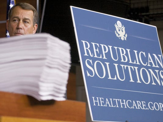 FILE - In this Oct. 29, 2009 file photo then-House Minority Leader John Boehner of Ohio stands behind a copy of the Democrat's version of the health care bill during a news conference on Capitol Hill in Washington. Boehner's announced exit as House speaker and from Congress altogether caps a political career that began as the head of a homeowners association in an Ohio neighborhood and made him second in line to the presidency.  (AP Photo/Harry Hamburg, File)