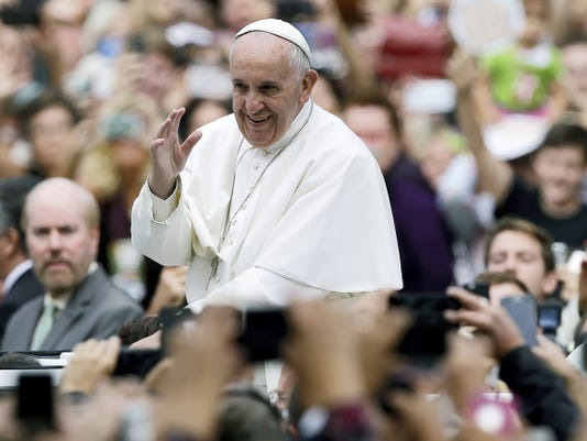 Pope Francis acknowledges faithful as he parades on his way to celebrate Mass Sunday, Sept. 27, 2015, in Philadelphia. (AP Photo/Matt Rourke, Pool)