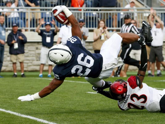 Penn State Nittany Lions running back Saquon Barkley (26) falls into the end zone for a touchdown vs. San Diego State on Saturday. His status for this week's game vs. Army is uncertain.