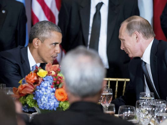 President Barack Obama and Russian President President Vladimir Putin greet each other during a luncheon, Monday, Sept. 28, 2015, at United Nations headquarters. (AP Photo/Andrew Harnik)