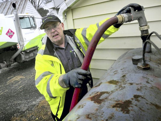 Ted Fox, of Shipley Energy, delivers heating oil last year to a home in Greencastle.