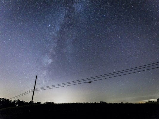 The milky way galaxy rises over a field near Dicks Dam Road, just north of New Oxford in Adams County during the Perseid meteor shower on Thursday morning.