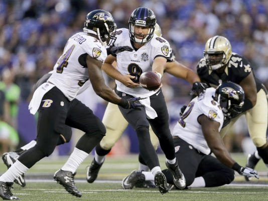 Baltimore Ravens' quarterback Matt Schaub (8) hands the ball off to running back Lorenzo Taliaferro (34) during the first half of Thursday's preseason game against the New Orleans Saints in Baltimore. The Ravens won, 30-27.