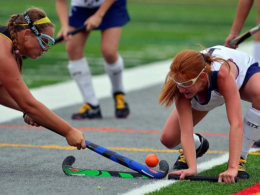 Red Lion's Hayley Taylor, left, battles Dallastown's Nicole Crumbing for the ball on Monday.