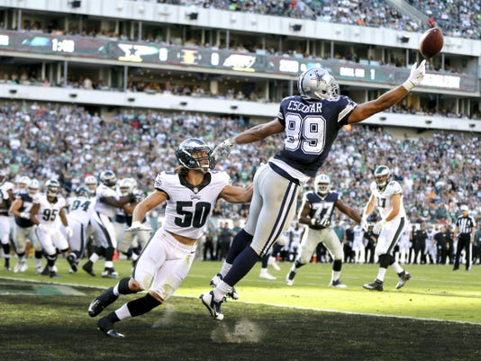 Dallas' Gavin Escobar (89) cannot reach a pass in the end zone as Philadelphia's Kiko Alonso (50) looks on during the first half on Sunday in Philadelphia. Alonzo won't play this coming Sunday vs. the New York Jets because he hurt his surgically repaired knee.