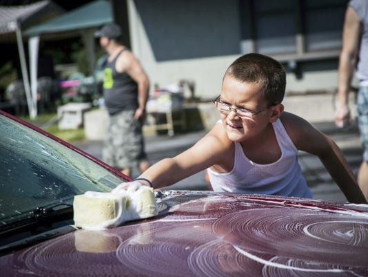 Jayden Thomas, 8, helps scrub down a car during the Sixth Annual Gavin Frank Bike and Car Wash Saturday. The event, held in memory of Gavin Frank, who died in October 2006 from Walker-Warburg Syndrome, was held at Highlander's Laundromat on Reinoehl Street in Lebanon. Proceeds from the event were going to Developmental and Disability Services of the Lebanon Valley.