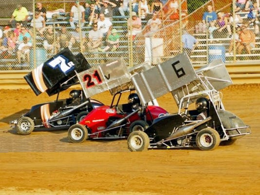 Ken Miller (7) battles Dave Ravel (21) and Mike Rutherford (6) in the Sportsman class at Lanco this past weekend in the Clyde Martin Memorial.