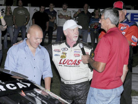 Bobby Gerhart Jr. and Dino Oberto, right, of Mahoning Valley Speedway, Lehighton, ask Justin Nicarry of Fredericksburg, Saturday night if would like to drive Gerhart's car around the track.