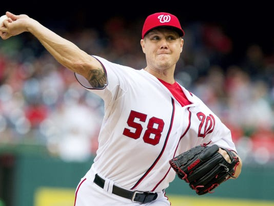 Nationals relief pitcher Jonathan Papelbon delivers during the eighth inning against the Phillies on Sunday in Washington. Papelbon got into a dugout fight with teammate Bryce Harper during the inning. Papelbon is suspended for the rest of the season.