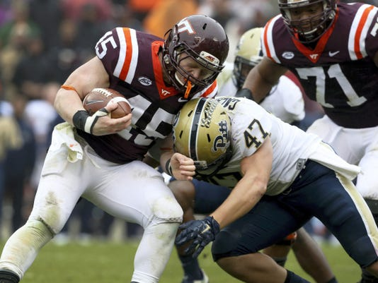 Virginia Tech fullback Sam Rogers (45) is tackled by  Pittsburgh linebacker Matt Galambos (47) during the second half.