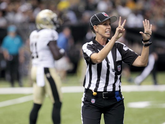 NFL referee Sarah Thomas works the game in the second half of an NFL preseason game between the New Orleans Saints and the Oakland Raiders at the Mercedes-Benz Superdome in New Orleans. Sarah Thomas is that much closer to taking the field as the NFL's first female official. She's part of a clinic for all refs with most training camps about two weeks away from opening.