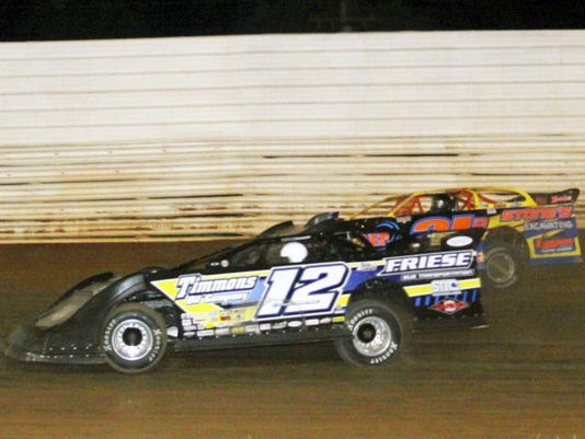 Devin Friese of Chambersburg, driving the No. 12 Late Model, makes a pass low on Dan Stone after the final restart on his way to a victory Saturday in the UFO Tri-Star Sizzler event. It was his first-ever win at Port Royal Speedway.