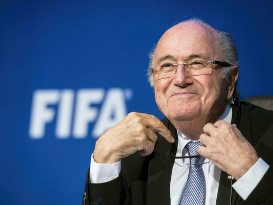 FIFA president Sepp  Blatter smiles  during a news  conference  at the FIFA headquarters in Zurich, Switzerland.