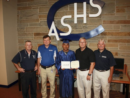 From left, Buddy Chapel, CASHS principal; Dr. Joseph Padasak, CASD superintendent; Abner David Cortez Garcia, graduate; Brad Ocker, CASHS associate principal; and Steve Cook, alternative education coordinator, are pictured after Cortez Garcia received his diploma.