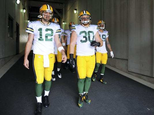 """Green Bay Packers quarterback Aaron Rodgers (12) said John Kuhn is (30) """"Pennsylvania tough"""" and is one of the only players that can rival him mentally in regards to the playbook."""
