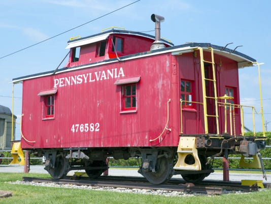 Harrison Jones — For The Evening Sun A Pennsylvania Railroad caboose from 1910, one of the last four-wheel wooden cabooses to be made, sits in front of the New Oxford train station during the Community All Aboard Day on Sept. 5.