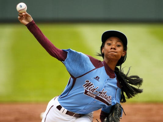 In this file photo, Pennsylvania's 13-year-old Mo'ne Davis delivers in the first inning against Tennessee during a baseball game in United States pool play at the Little League World Series tournament in South Williamsport, Pa. Little League is getting younger. The organization announced Thursday it is changing its age requirement, phasing out 13-year-olds from the league.