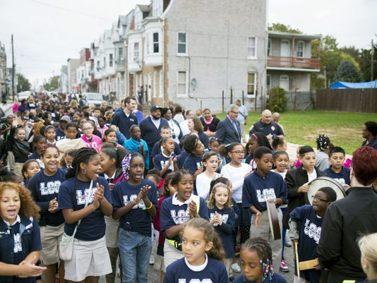 Lincoln Charter School in York celebrates International Walk to School Day with a walk around the neighborhood and a pep rally promoting a safe and healthy lifestyle Wednesday. But the state budget impasse is starting to affect the school. Lincoln Charter's  principal said the school might have to take out a line of credit if the impasse continues.