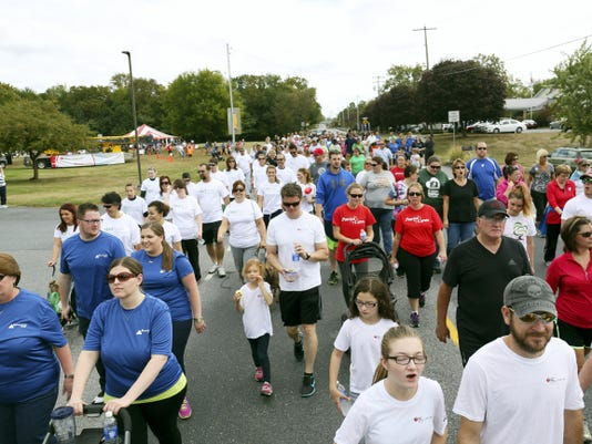 Participants take to the streets Sunday during the 2015 Mason Dixon Heart & Stroke Walk in Greencastle.