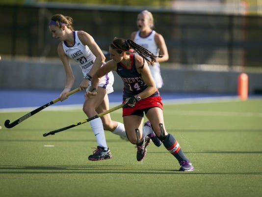 Liberty University's Sarah Gipe, of Greencastle (14), plays against James Madison University during a game this season. Gipe is playing in her final season for the Flames.
