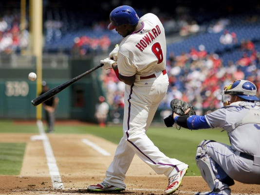Philadelphia Phillies' Ryan Howard, left, hits a two-run single off Los Angeles Dodgers' pitcher Zack Greinke during the first inning Thursday in Philadelphia. At right is catcher Yasmani Grandal.