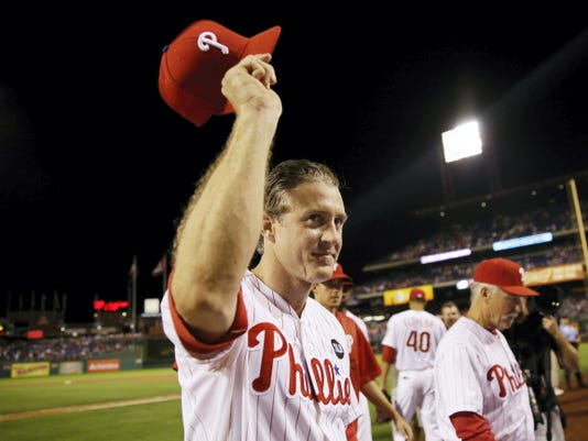 The Philadelphia Phillies' Chase Utley acknowledges cheers from the crowd after a baseball game against the Toronto Blue Jays Wednesday in Philadelphia. Philadelphia won, 7-4, amid reports Utley would be traded to the Dodgers. Utley's locker had been cleared out and he was not in the clubhouse once reporters were granted access to the clubhouse.