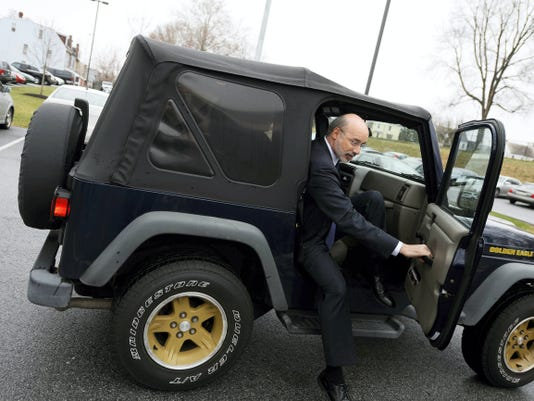 Kate Penn - Daily Record/Sunday News   In this April 2015 file photo, Gov. Tom Wolf gets out of his Jeep during a visit to the J.D. Brown Center for Entrepreneurship at the Kings Mill Depot at York College.