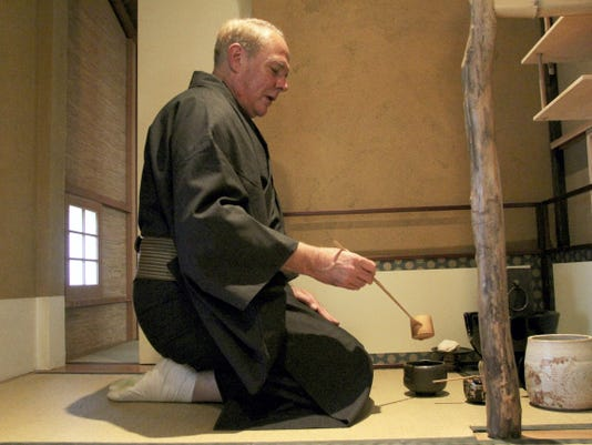 Todd Frey, who teaches traditional Japanese tea lessons, prepares the drink at his backyard teahouse located in West York.
